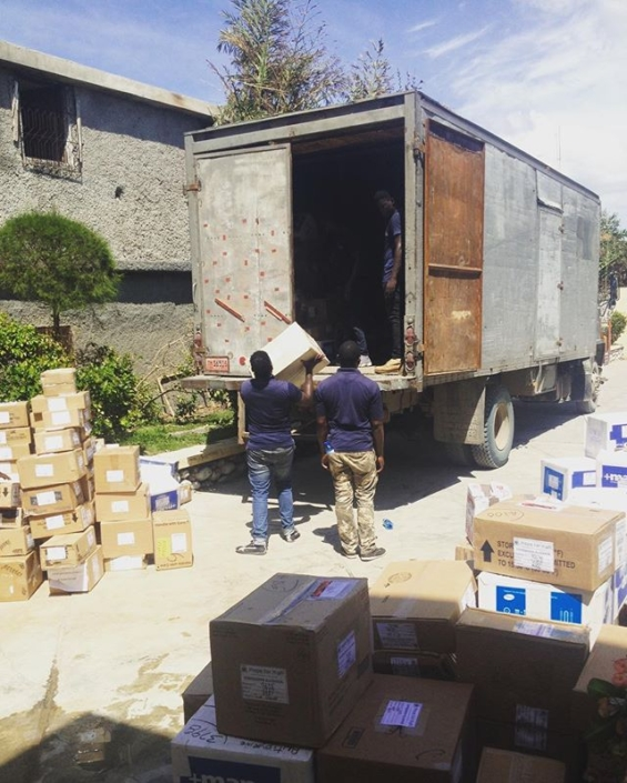 Unloading a truck of supplies that will be distributed to our partners and those at most risk throughout the greater south. #haiti #hopeforhaiti #hurricanematthew #blueboxes