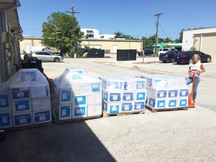 It's always a good day when it's a @mapintl day. we are incredibly grateful to our partnership with map international and their unwavering dedication to serving the haitian people. these #blueboxes are filled with life saving medications and medical supplies that are headed to #haiti! #thankyou #mesianpil shout out to our gift in kind program director @cgrassi212 the muscle behind our #healthcare program. #hopeforhaiti #teamhope #womenwholift